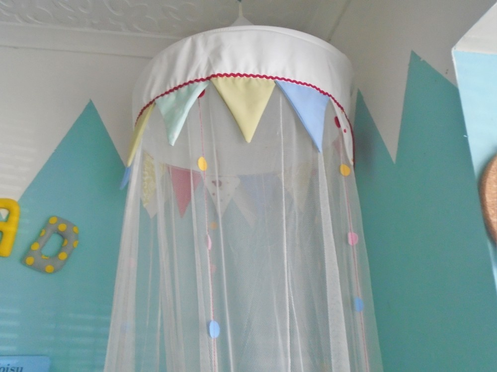 Ikea canopy in the corner of the reading nook