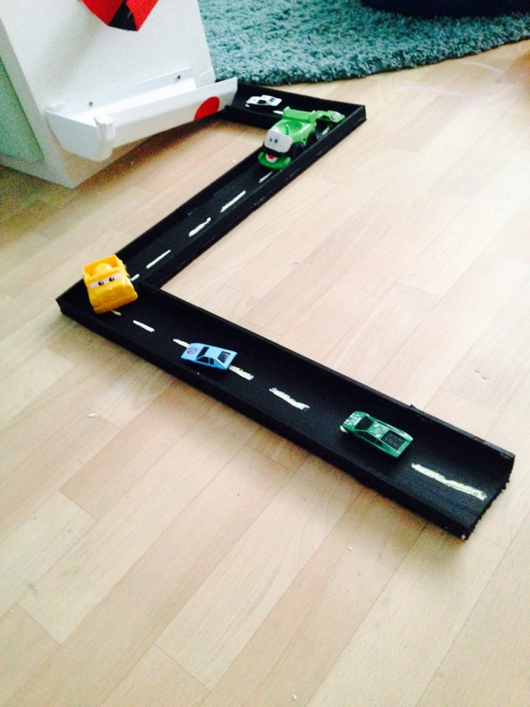 Timber floor boards turned into a car track