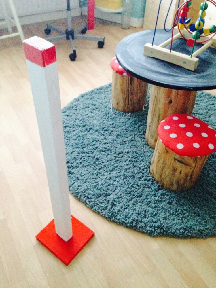 Toadstool table and chairs made from tree stumps