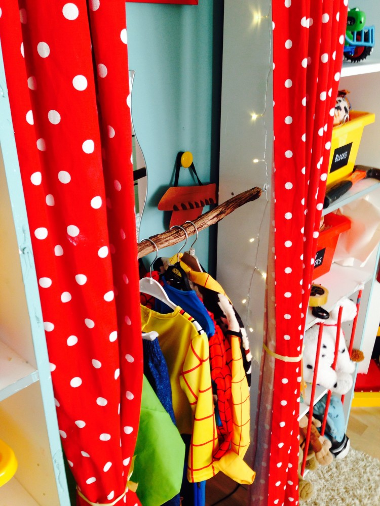 Another close up image of the dress up area, with red polka dotted curtains