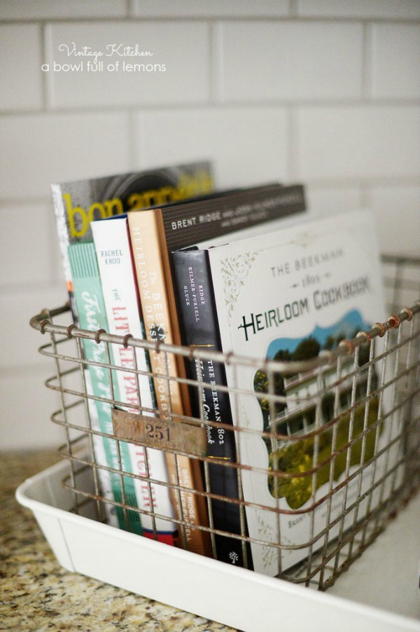 store cookbooks in vintage baskets to declutter kitchen counters via A bowl full of lemons / Grillo Designs www.grillo-designs.com