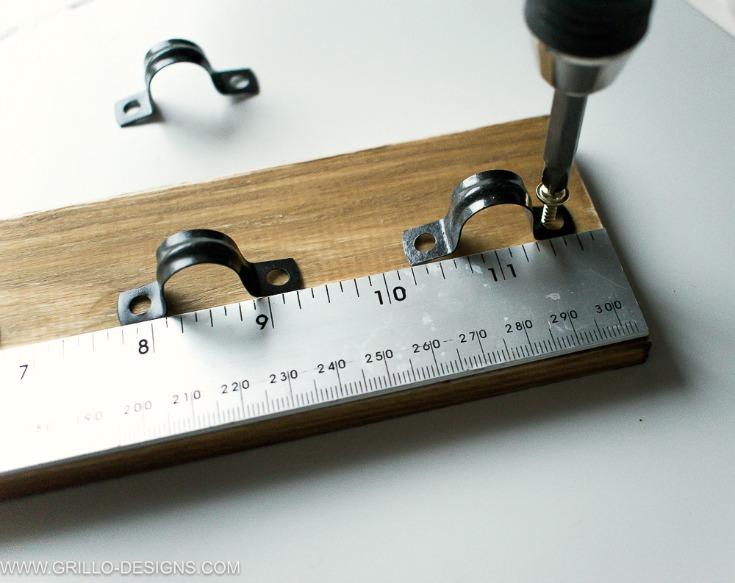 screw in plumbing clips to make a diy utensil rack holder/ Grillo Designs www.grillo-designs.com