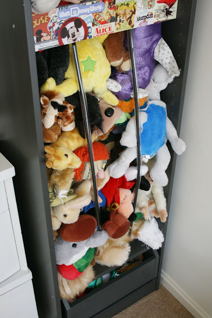 IKEA toy storage hacks - stuffed animal storage with the IKEA PAX bookcase / Grillo Designs