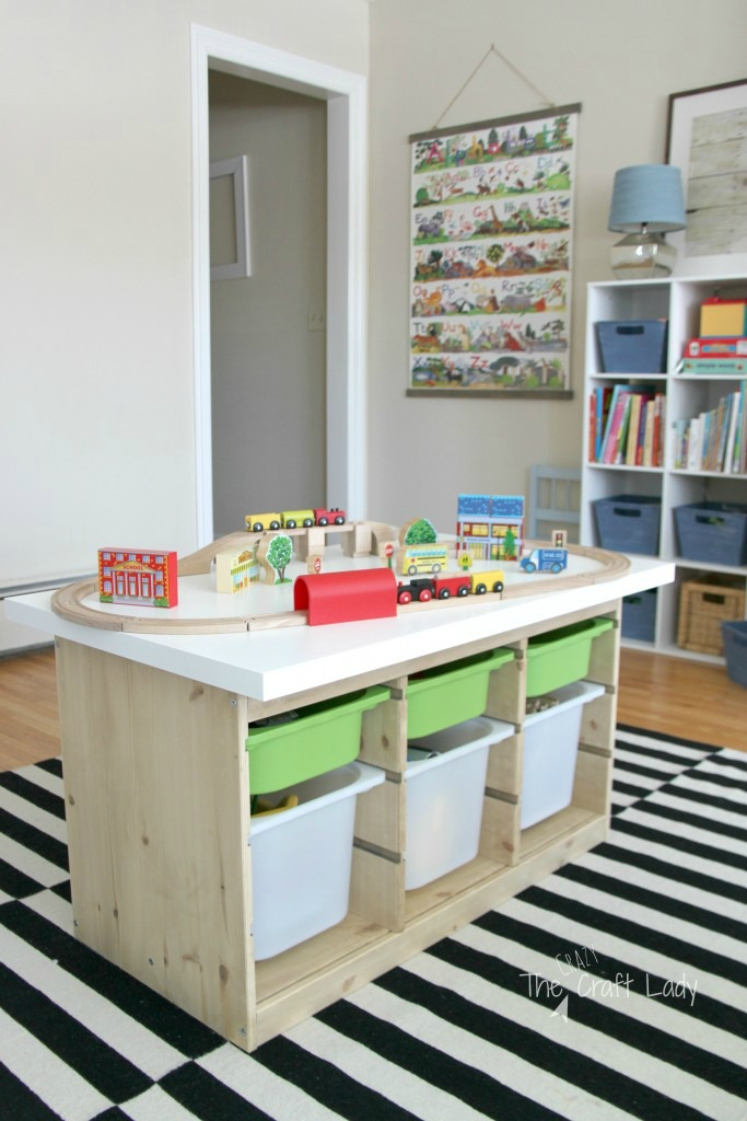 Ikea trofast hacks - a train table made from trofast units on tip of a black and white striped table in a kids bedroom