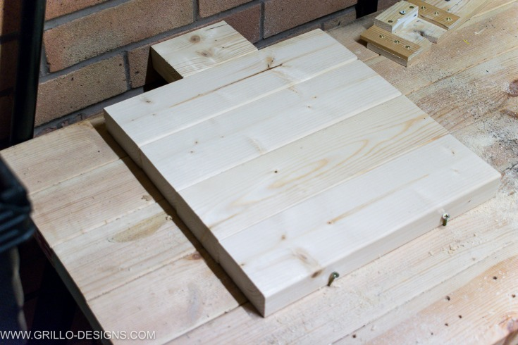 Clamp the wood together to make the table top for the industrial side table / Grillo Designs www.grillo-designs.com