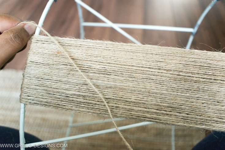 Wrapping jute string around frame to make a diy jute lampshade