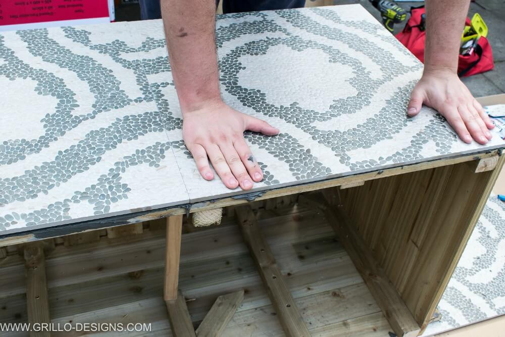 Press tiles firmly in place to the sides of the diy trough planter / grillo designs
