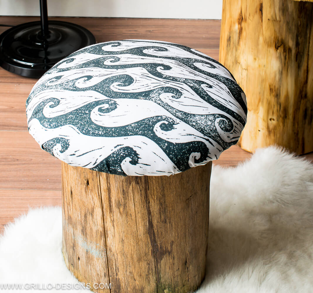 Monochrome toadstool with diy tree trunk table / grillo designs