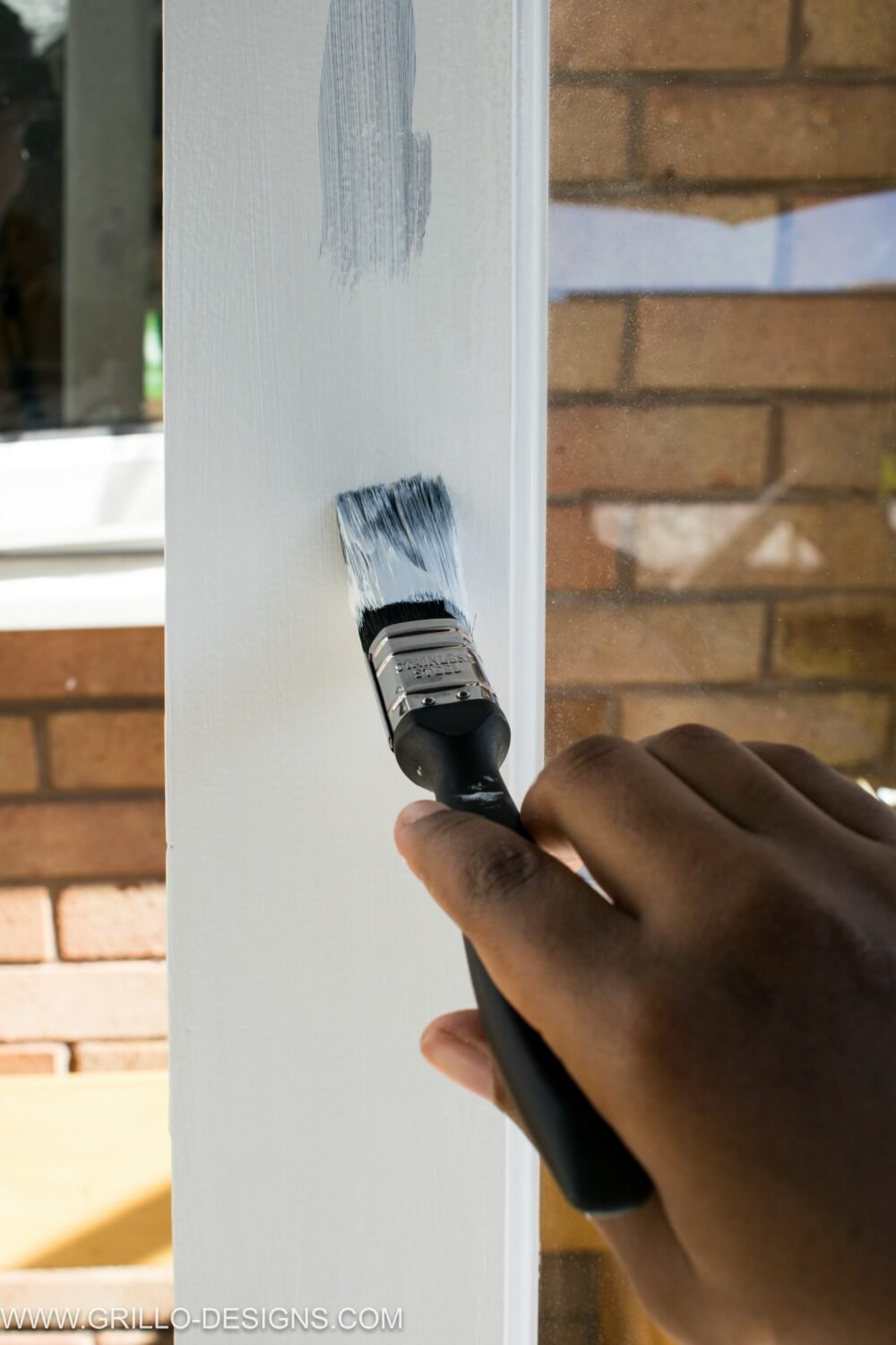 Paint glass panel doors tutorial - apply primer with a paint brush to the doors