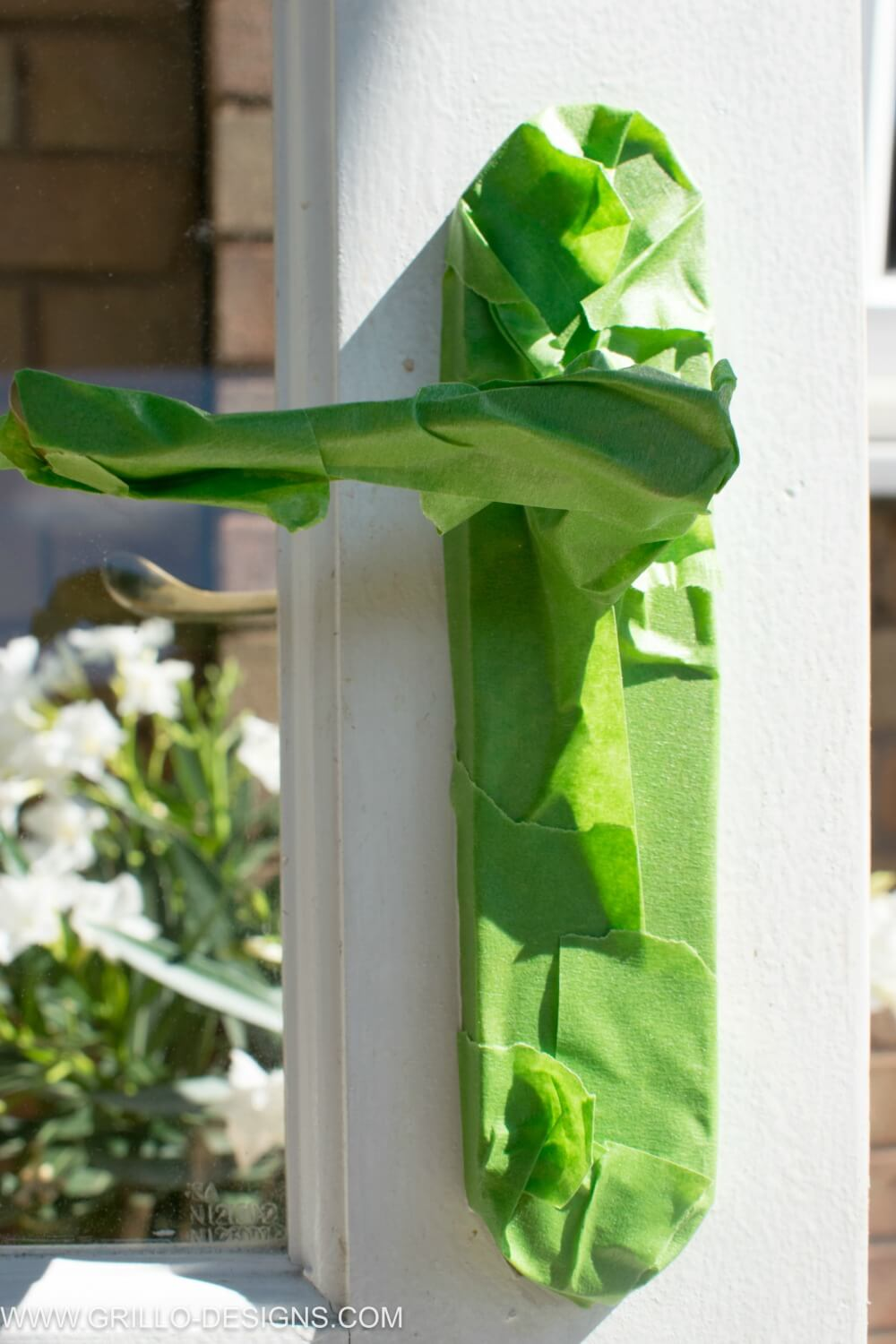 Use masking tape to protect the handles when painting glass panel doors