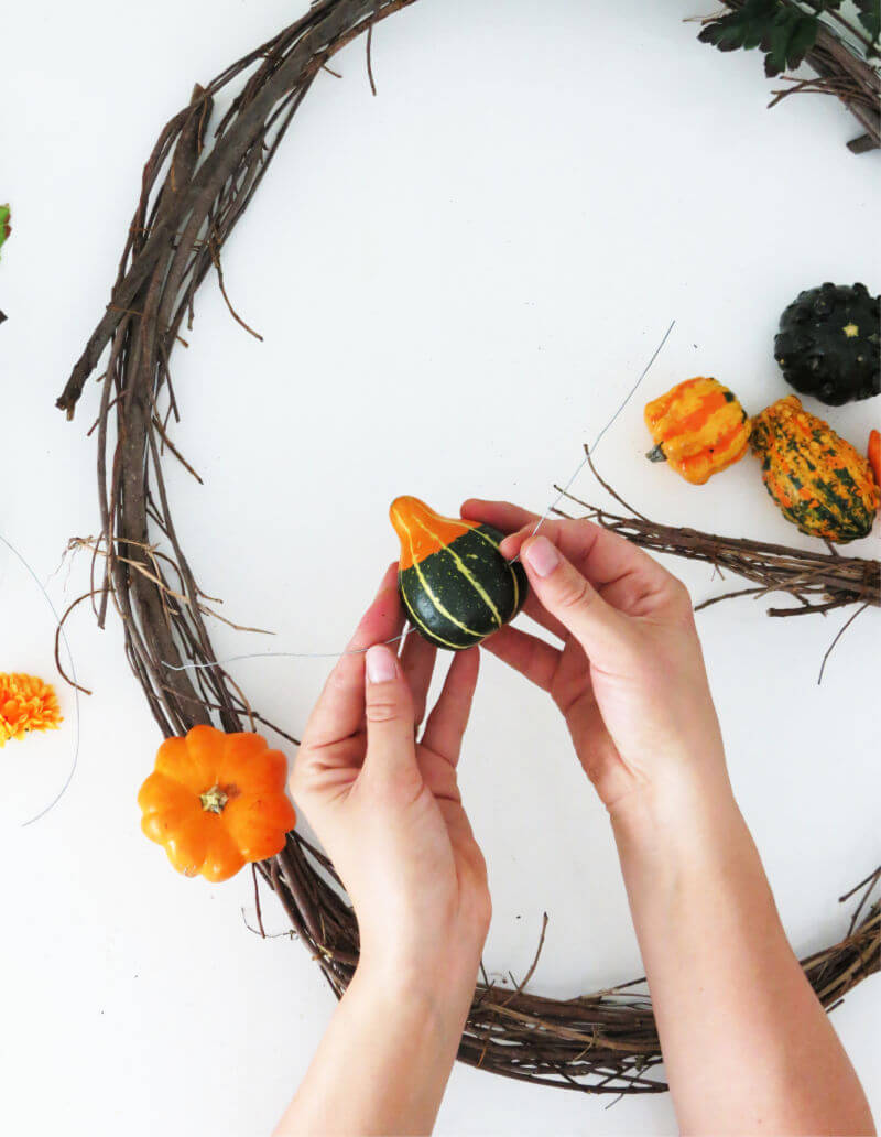 Drill holes into pumpkin wreaths before attaching to DIY monogram wreath / grillo designs