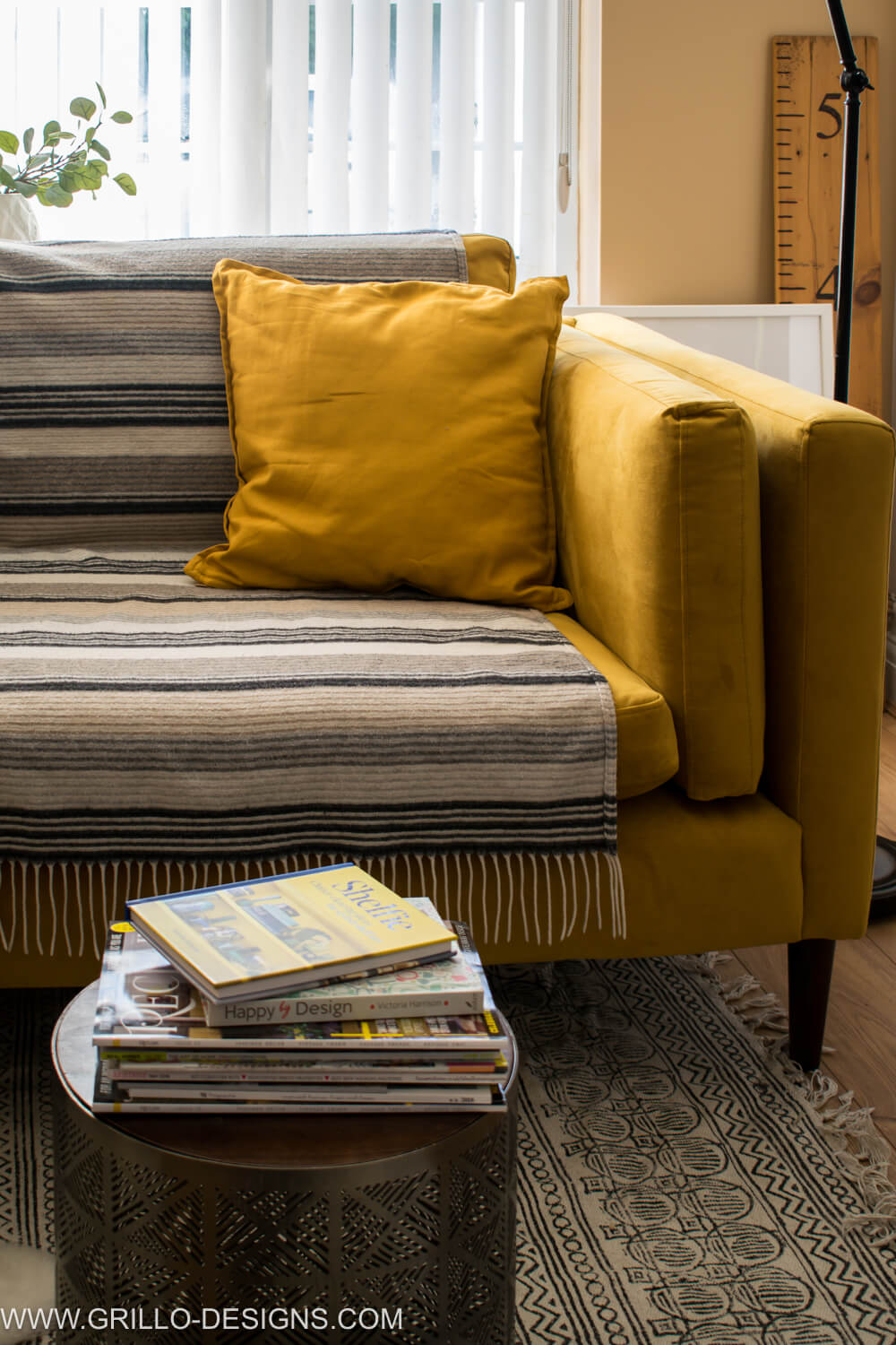 Use throws and blankets to cover velvet sofa / grillo designs