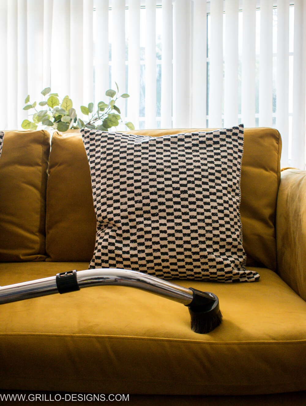 Use a brush attachment to vacuum a velvet sofa / grillo designs