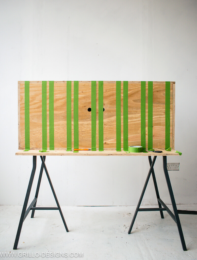 Creating paint stripes on the diy tv stand
