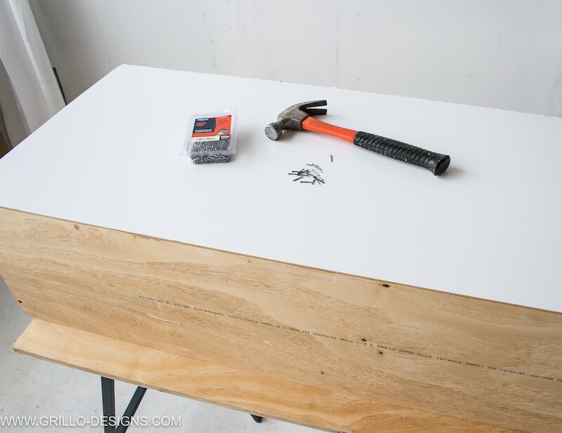 Nail in the backing to the diy tv stand