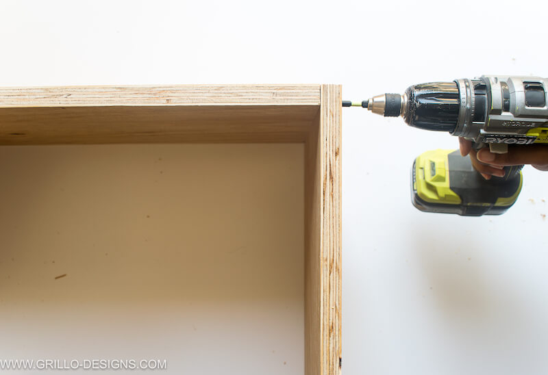 Insert screws to make the diy tv stand more stable