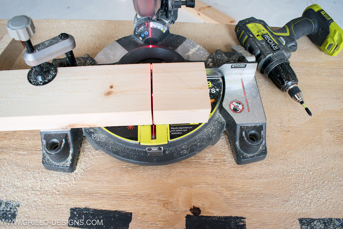 Use the mitre saw to cut the wood to size to make the top and sides of the overbed table