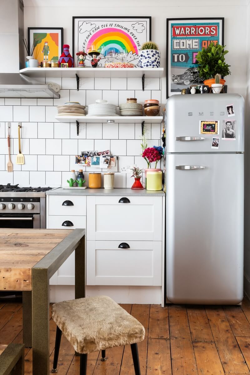A colourful rental : smeg fridge in open plan kitchen