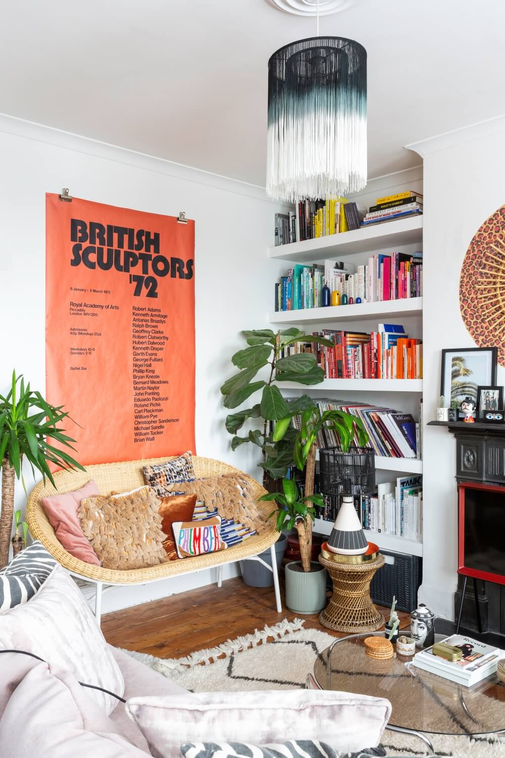 A colourful rental : colour coded book shelf in the living room
