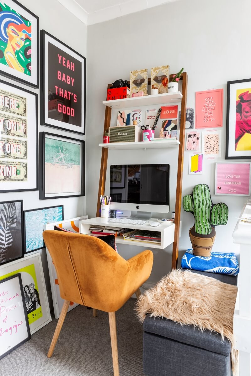 A colourful rental: A side view of an small space office desk