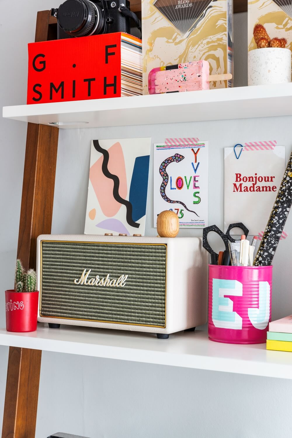 A colourful rental: Marshall radio on the second shelf of west elm desk