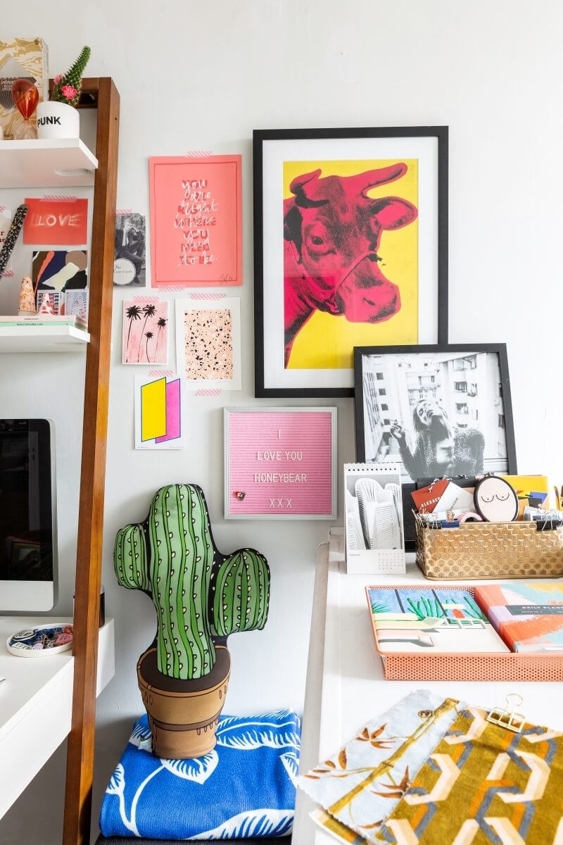 A colourful rental: Colorful desk accessories in a small space office area