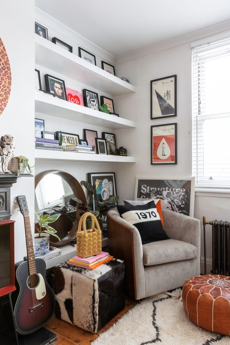 A colourful rental : shelves in the living room displaying art