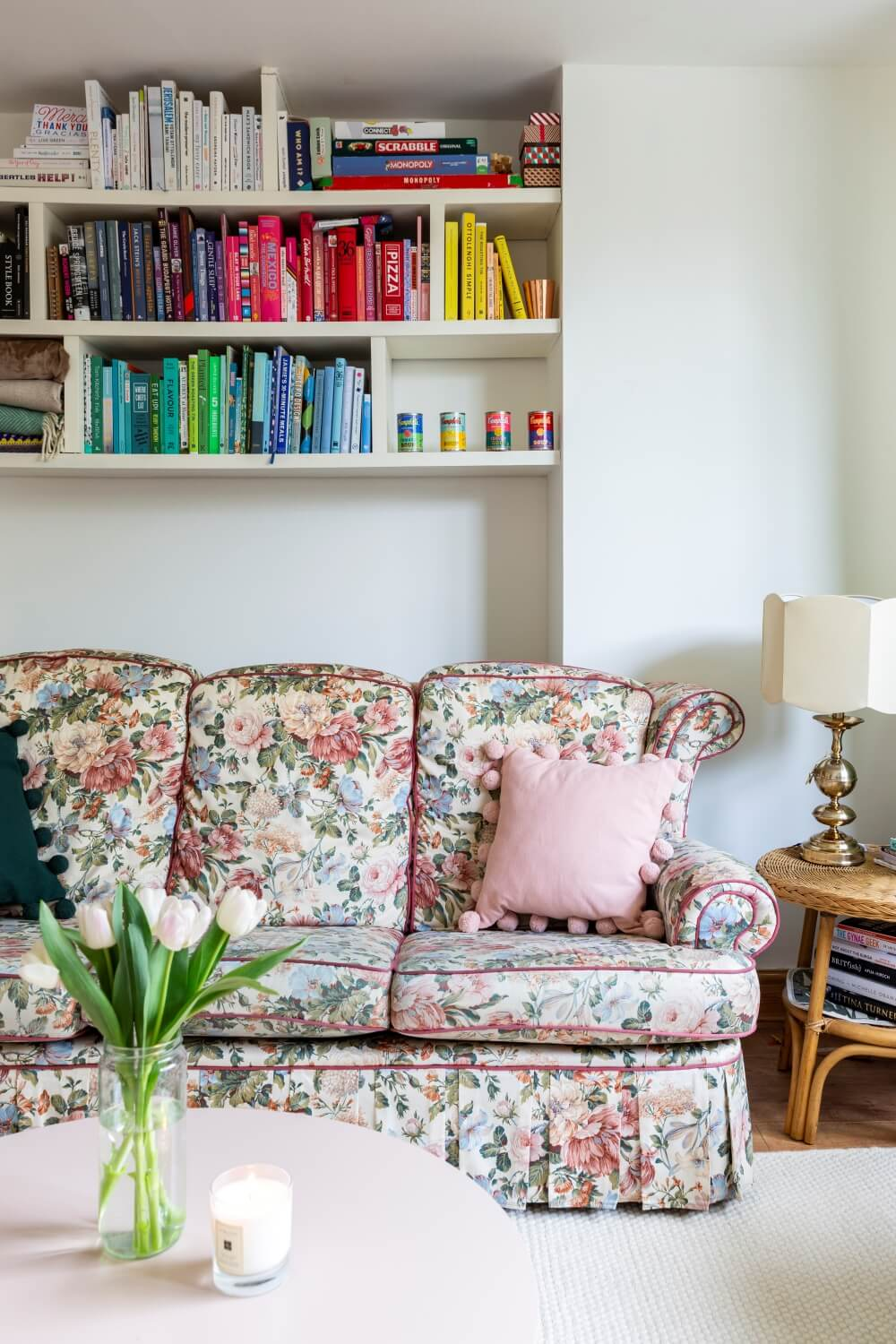Decorate with Pink Home tour: Floral vintage sofas in a living room against a wall with books organised by colour