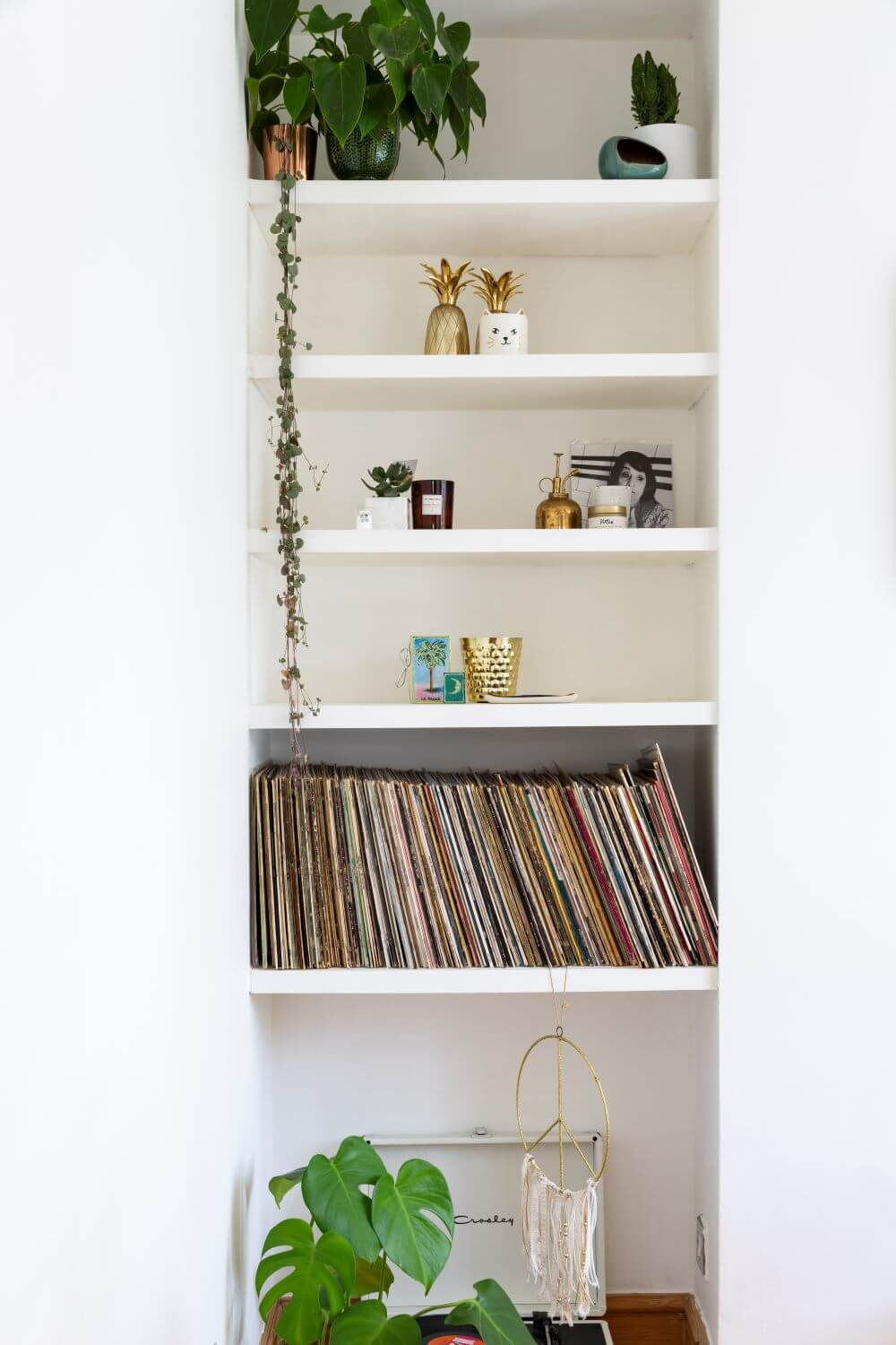 Decorate with Pink Home tour: Styles white shelves alcove with plants and records