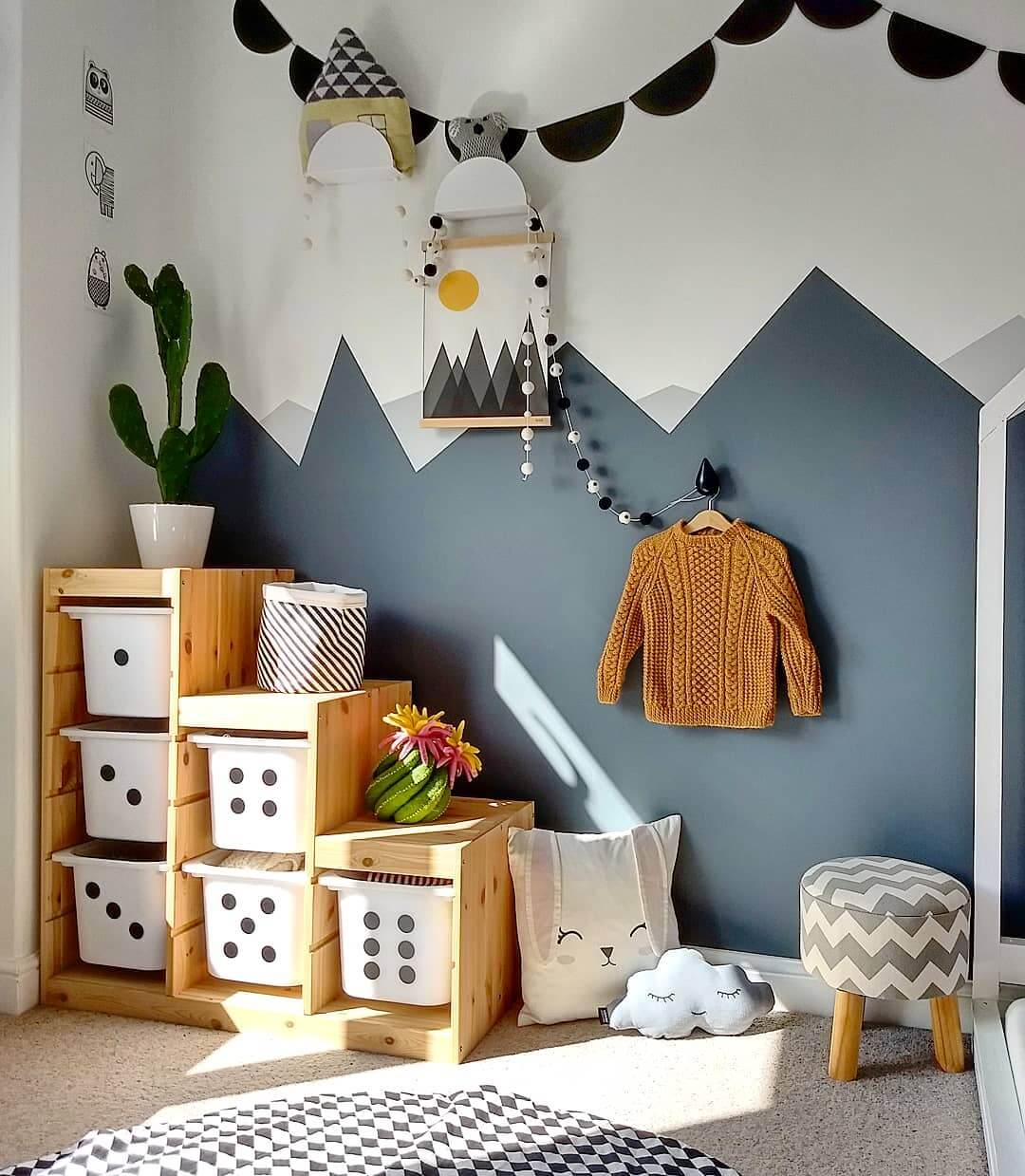 IKEA TROFAST HACKS - trofast unit placed in a childs room against a feature blue scandi painted wall.