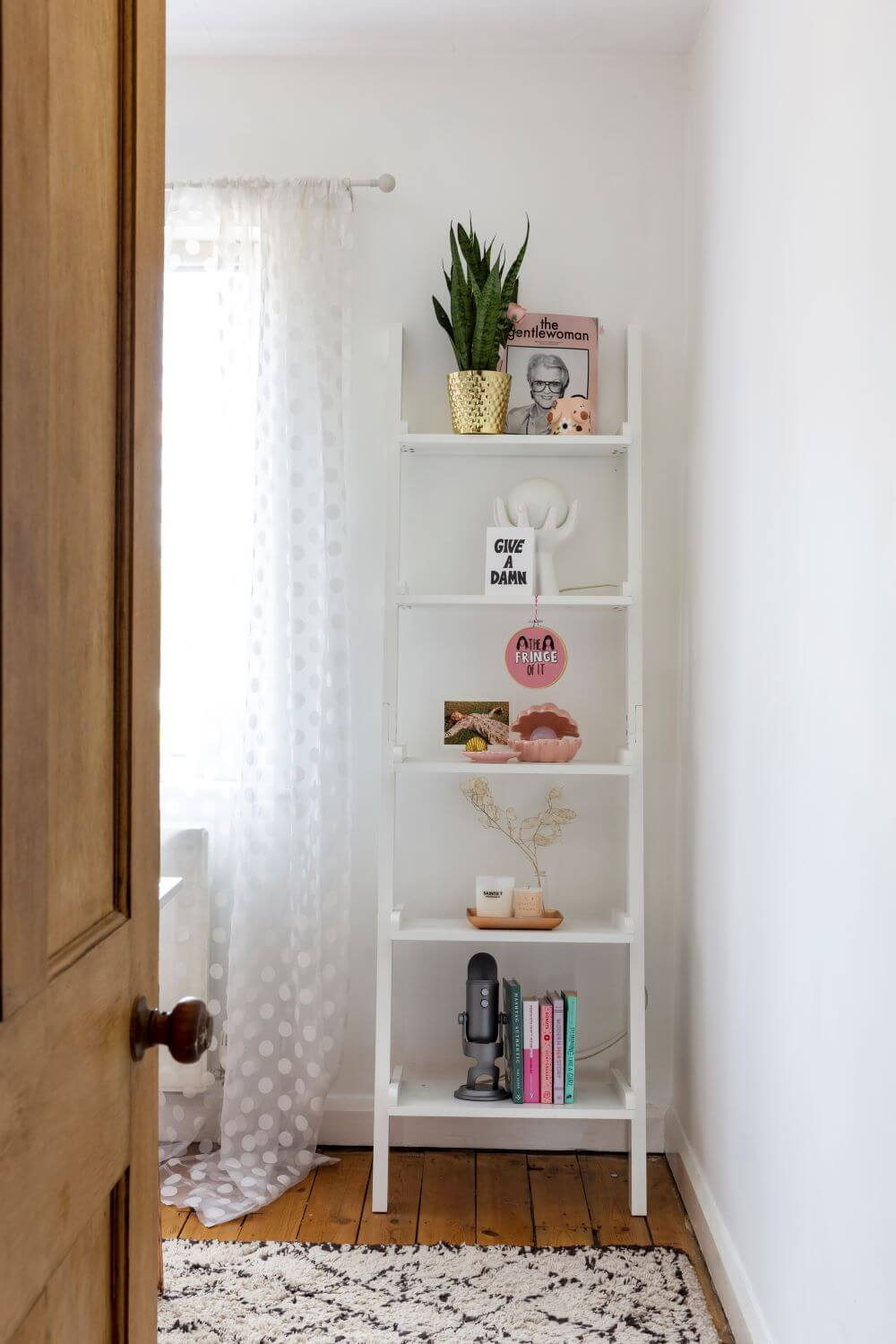Decorate with Pink Home tour: White styled shelves leaned against the wall in the office next to the window
