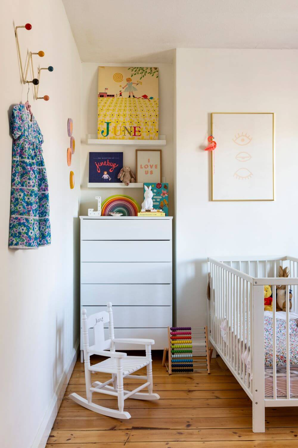 Decorate with Pink Home tour: Girls bedroom with DIY white chest of drawers next to a baby cot and rocking chair