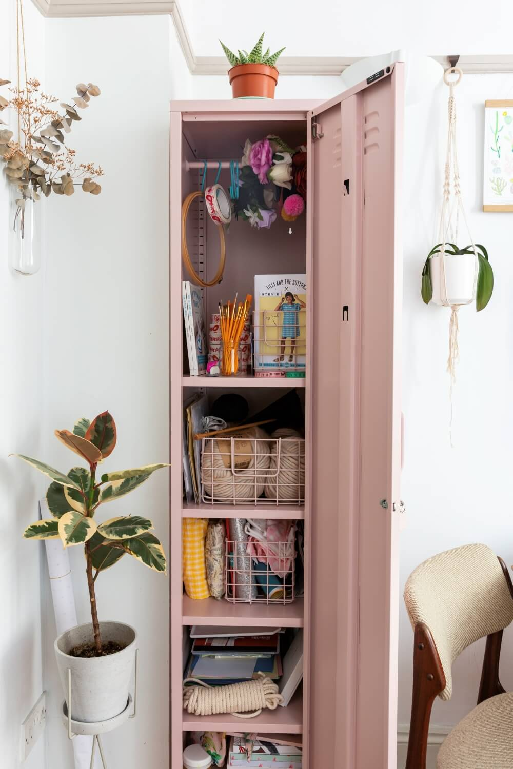 A look inside the pink mustard locker . Shelves of craft storage