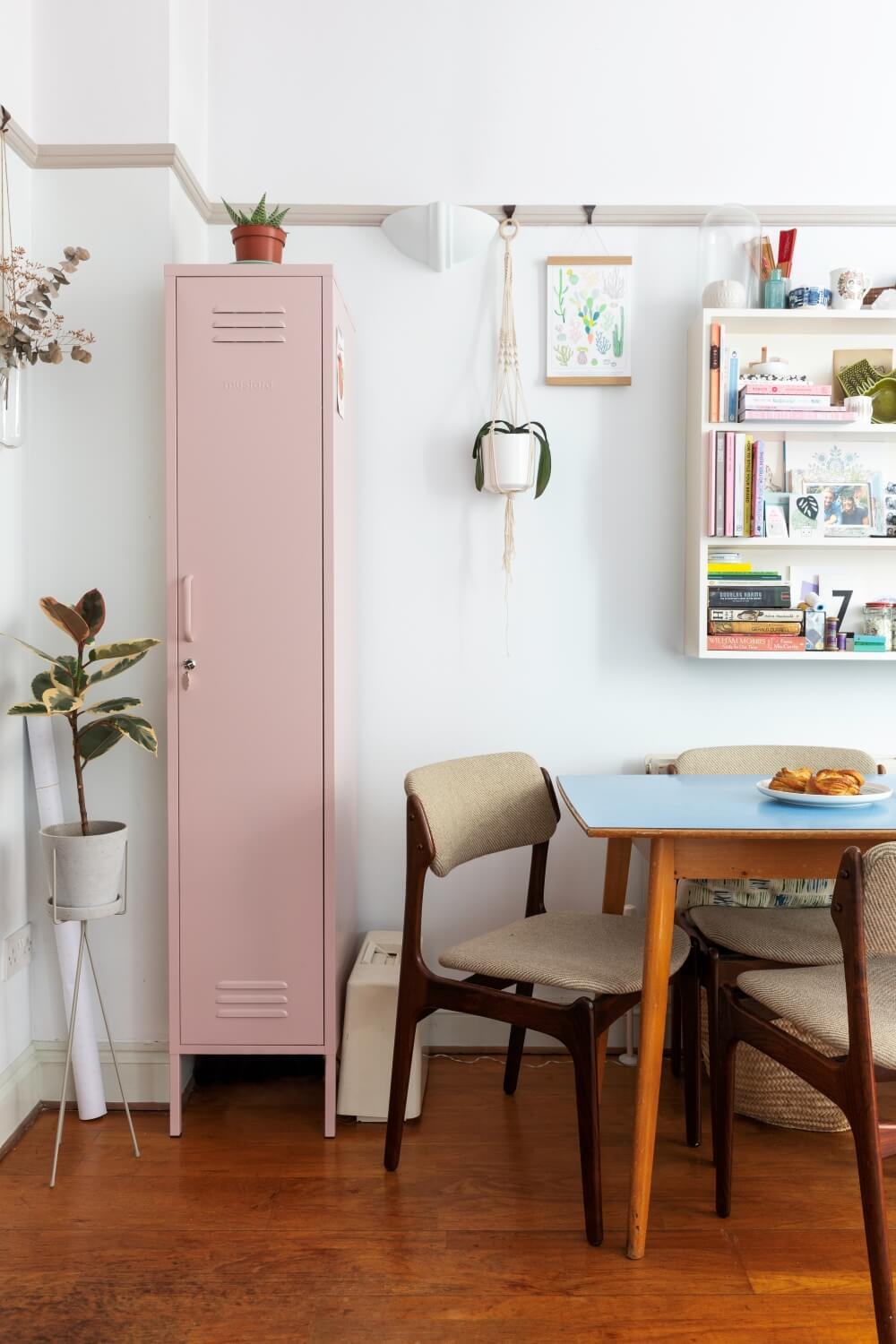 pink Mustard locker in the living room for extra storage next to dining table