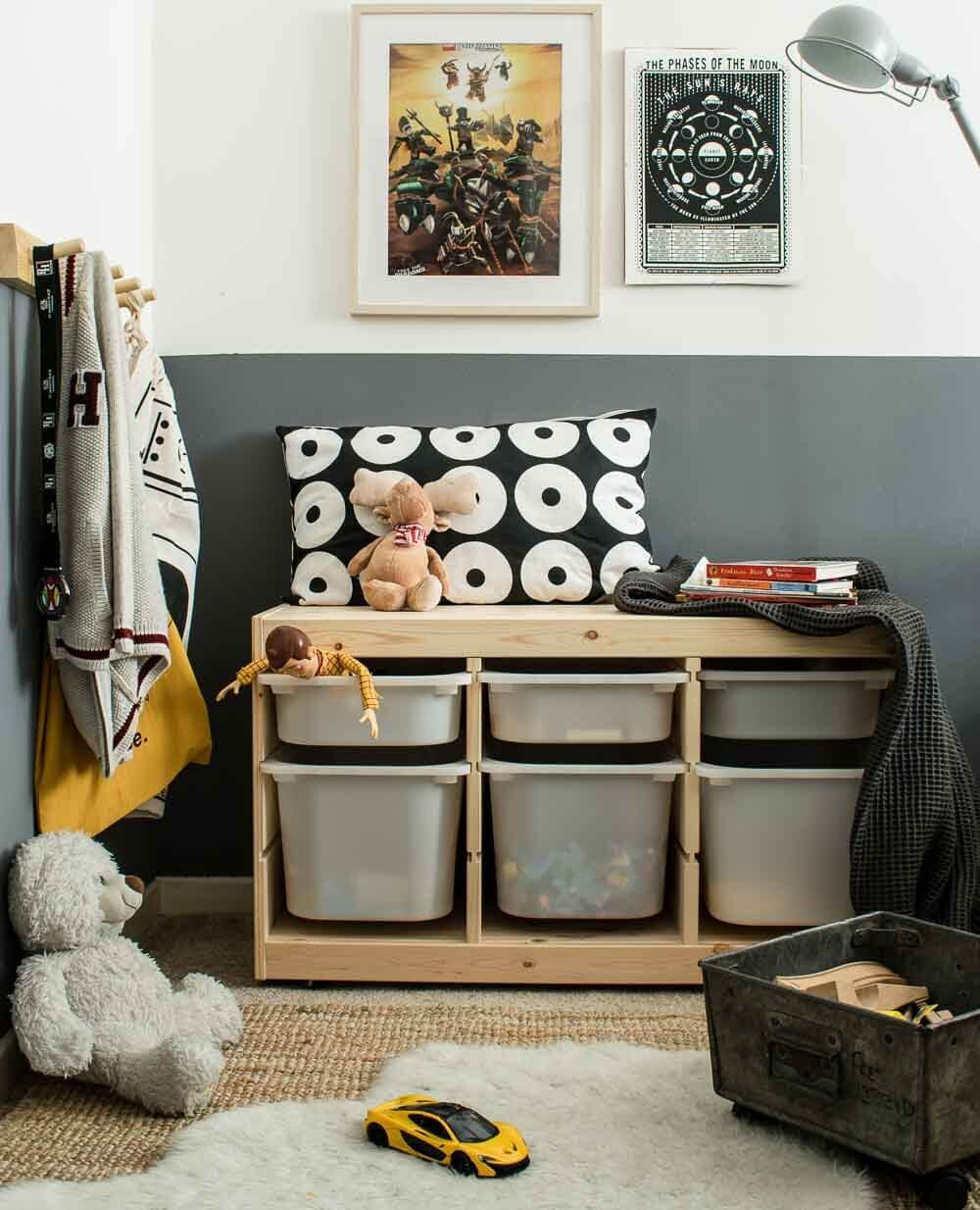 IKEA TOFAST HACKS - A Pine trofast unit against a grey wall surrounded by kids toys