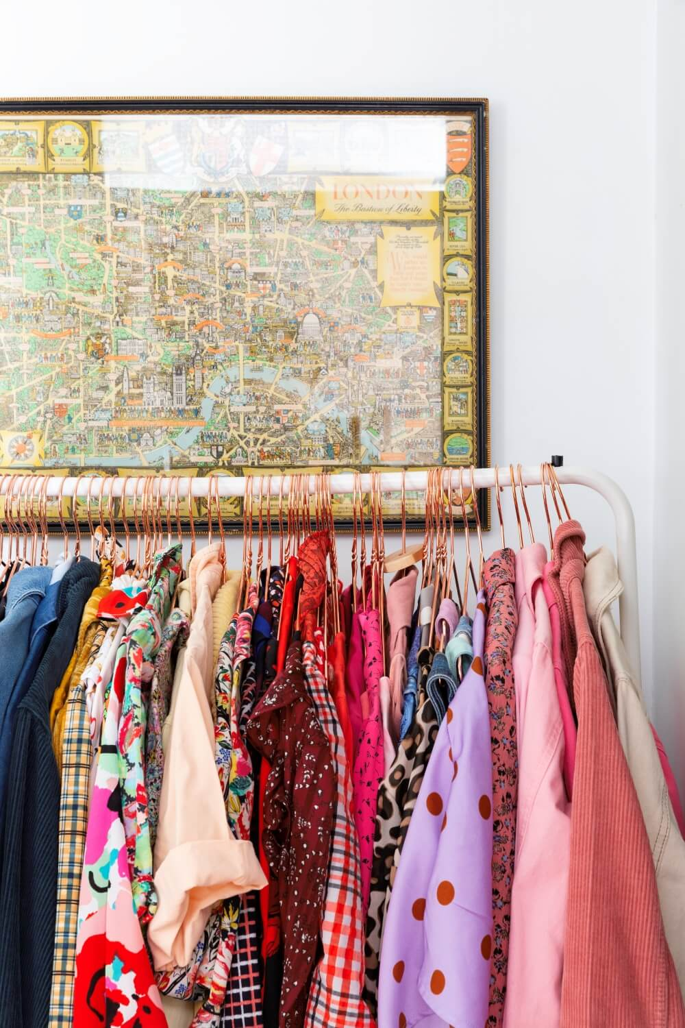 Clothes rail in hallway with colourful dresses