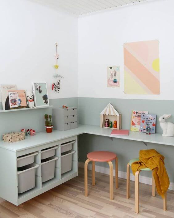 trofast units wall mounted and used to create a desk space in a kids bedroom. Pine trofast painted a pale green to match the wall