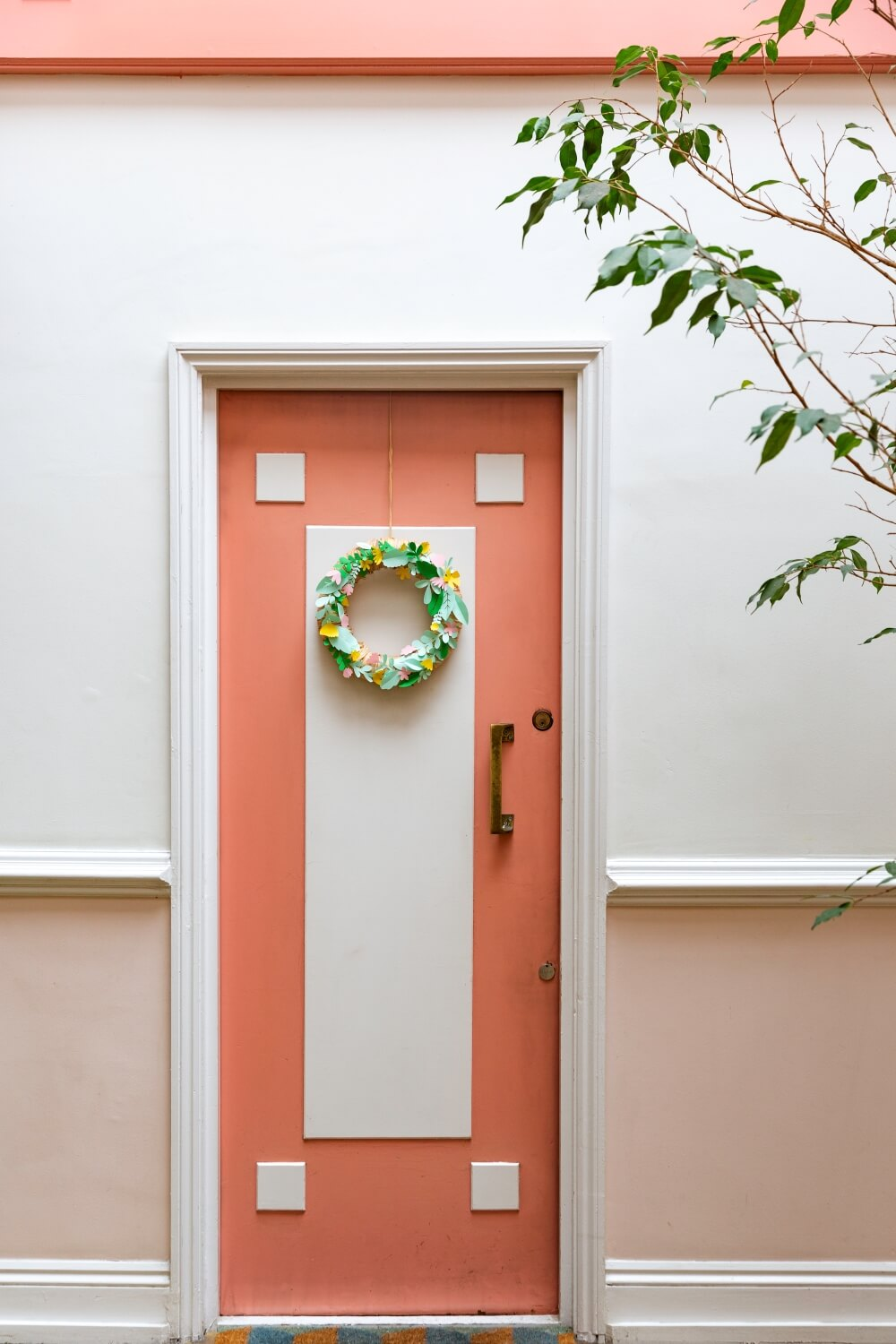 A pink pastel art deco front door in listed building