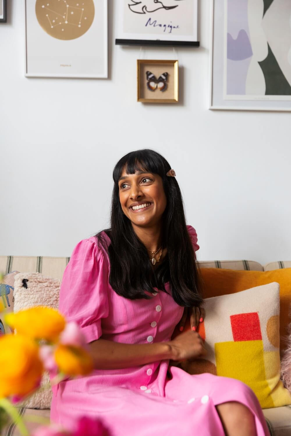 Zeena shah on sofa looking out of the window of her listed building home