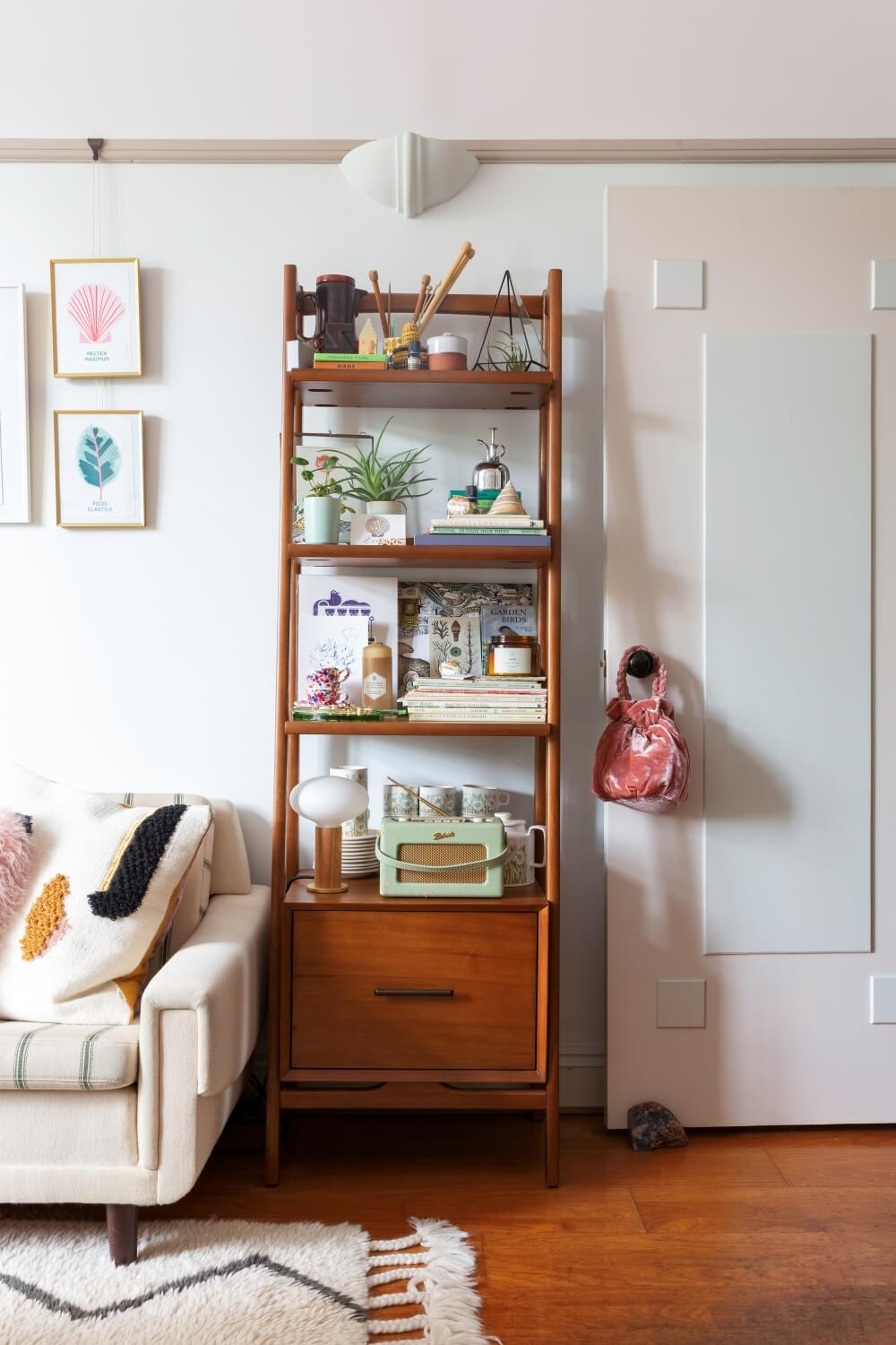 West elm bookcase in living room used to store decorative items and homeware