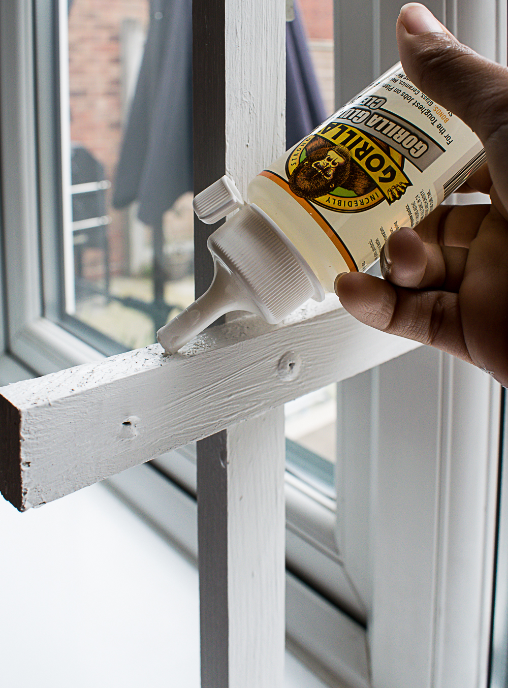 Applying the gorilla clear glue to the top of the brackets