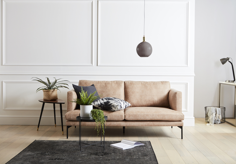 The tom sofa from the so simple range in the leather look fabric against a white paneled wall