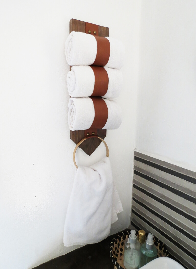 diy towel storage holder hung from the wall