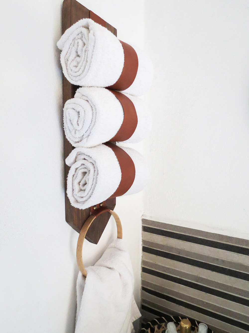 View of diy towel storage holder on the wall from the side