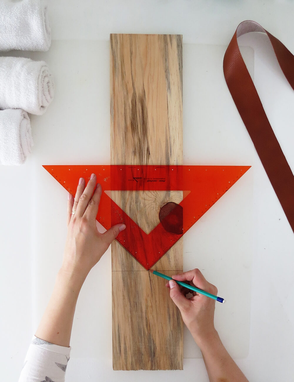 Use a triangle ruler to mark on the wood