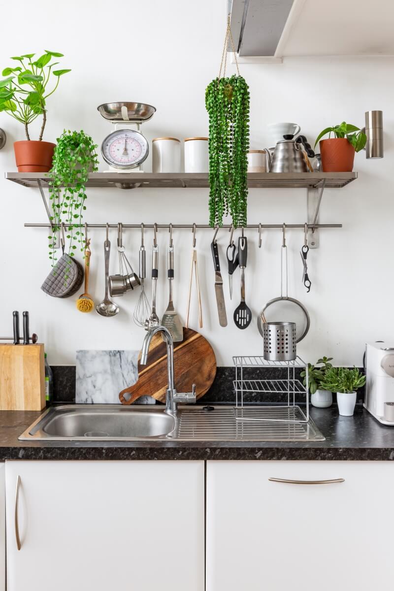 Hanging utensils rack above kitchen counter tops
