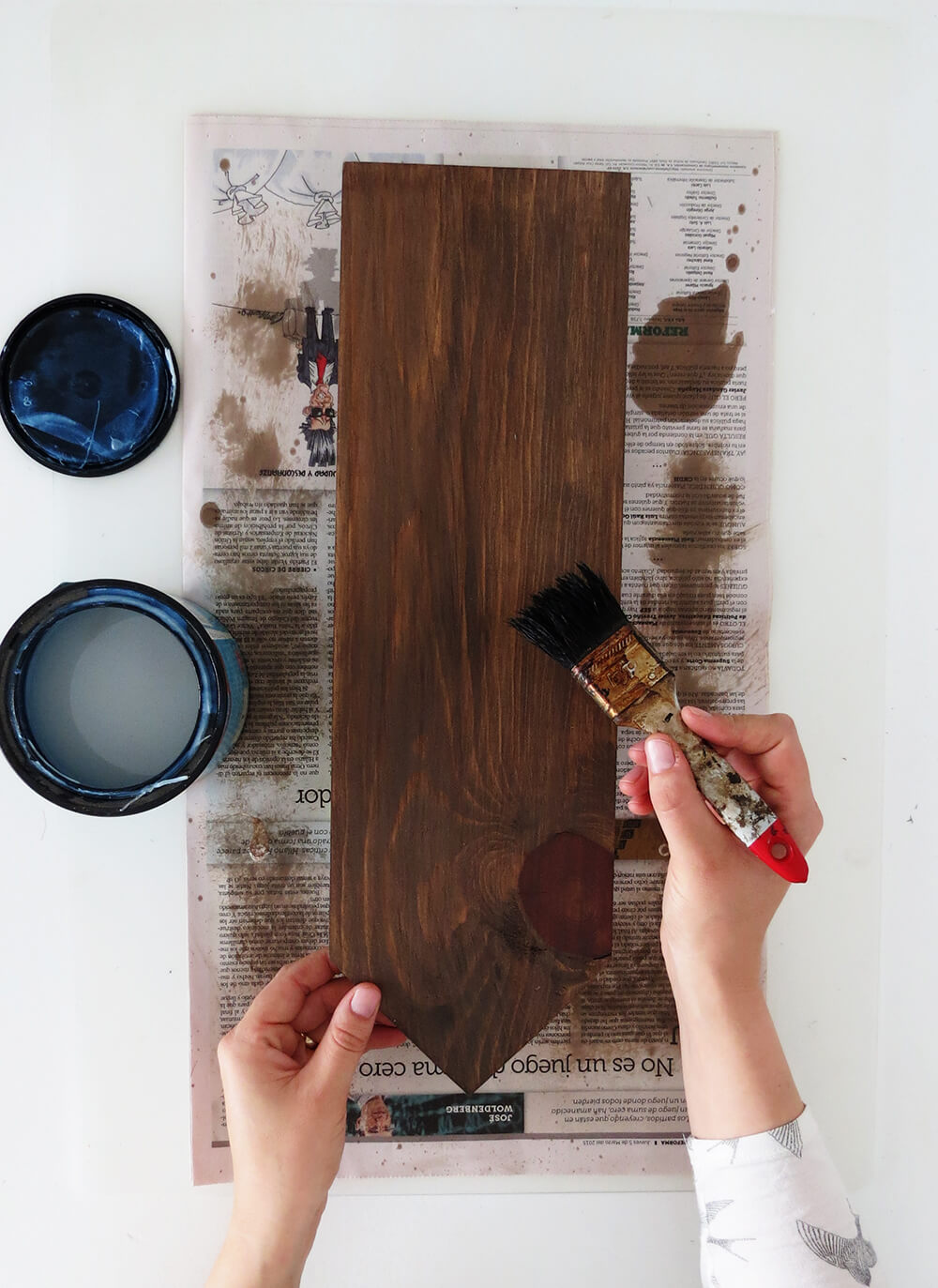 Stain the wood with a paintbrush