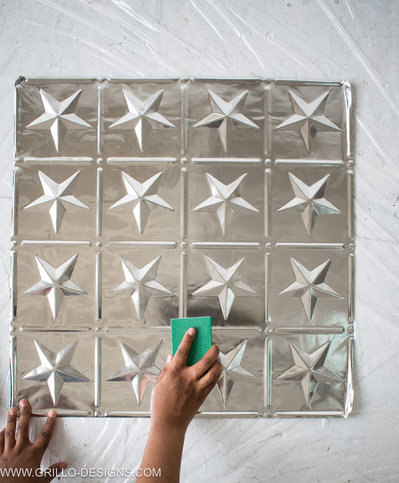 Use a sanding block to sand tin tiles