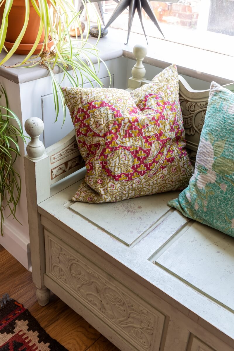 Window seat with desi inspired cushions