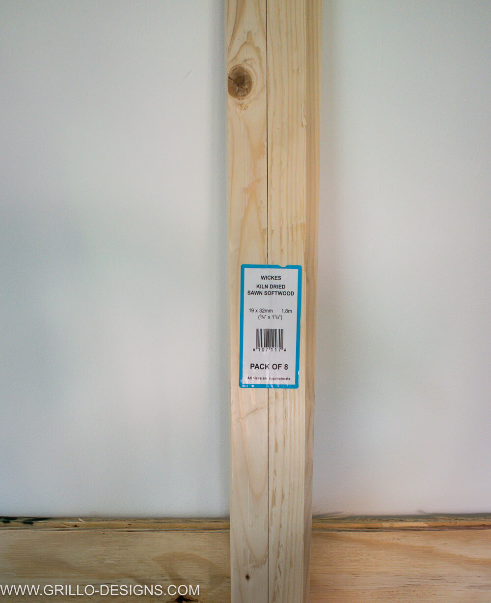 Sawn 8-pack of kilo softwood, leaning against a white wall